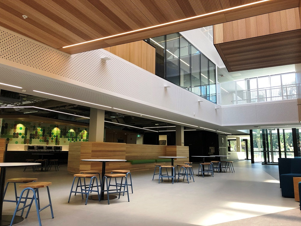 Interior area with tables and stools at Adelaide Botanic High School.