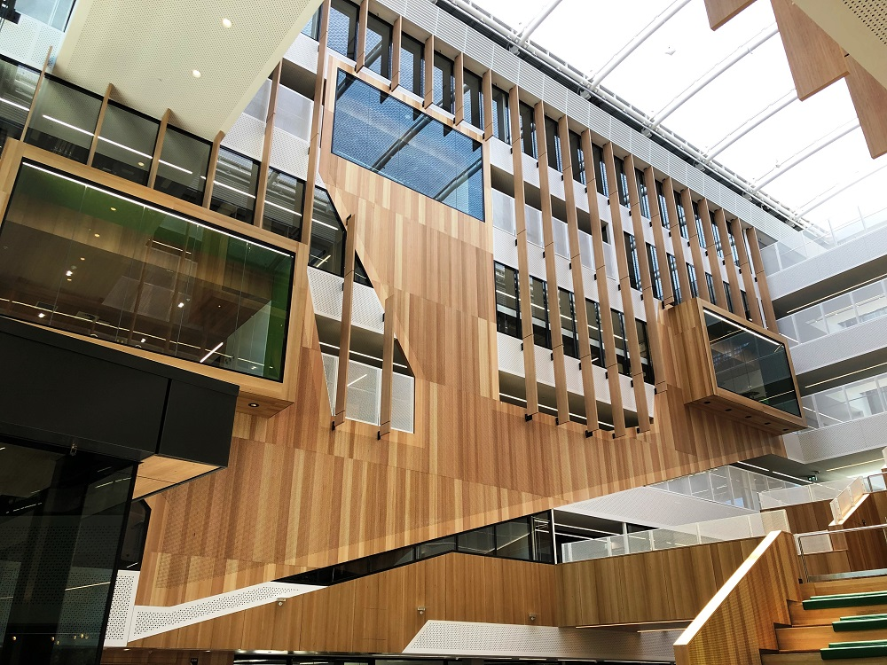 Interior of Adelaide Botanic High School, showing a staircase and raised walkway.