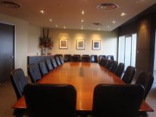 An image of the boardroom in the Education Development Centre, featuring a large table.